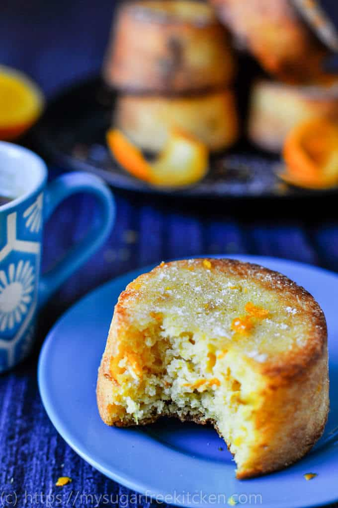 A bite of sugar free orange and Almond cake with 5 grams of protein enjoyed with a morning coffee