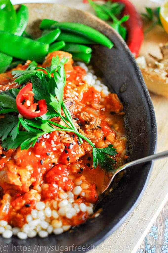 Spicy Chicken slow cooker packed with flavour and rich tomato sauce, served with pearl cous cous and healthy greens | Clean Eating | Under 400 calories per serve