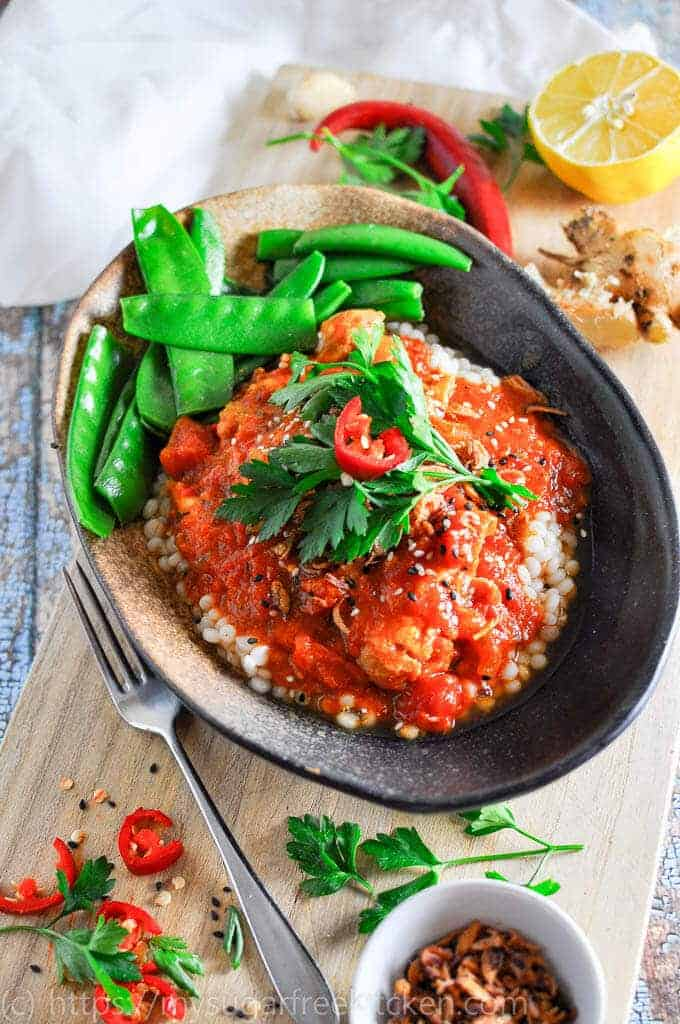 Serve this rich, warming spicy Chicken slow cooker recipe for dinner with peal cous cous and healthy greans  