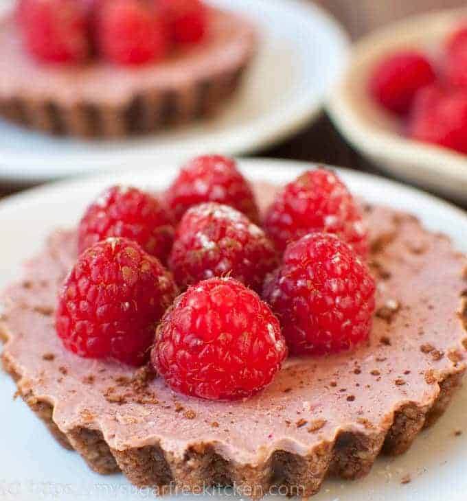 Sugar Free Chocolate Tart, covered with fresh raspberries and dusted with icing sugar.