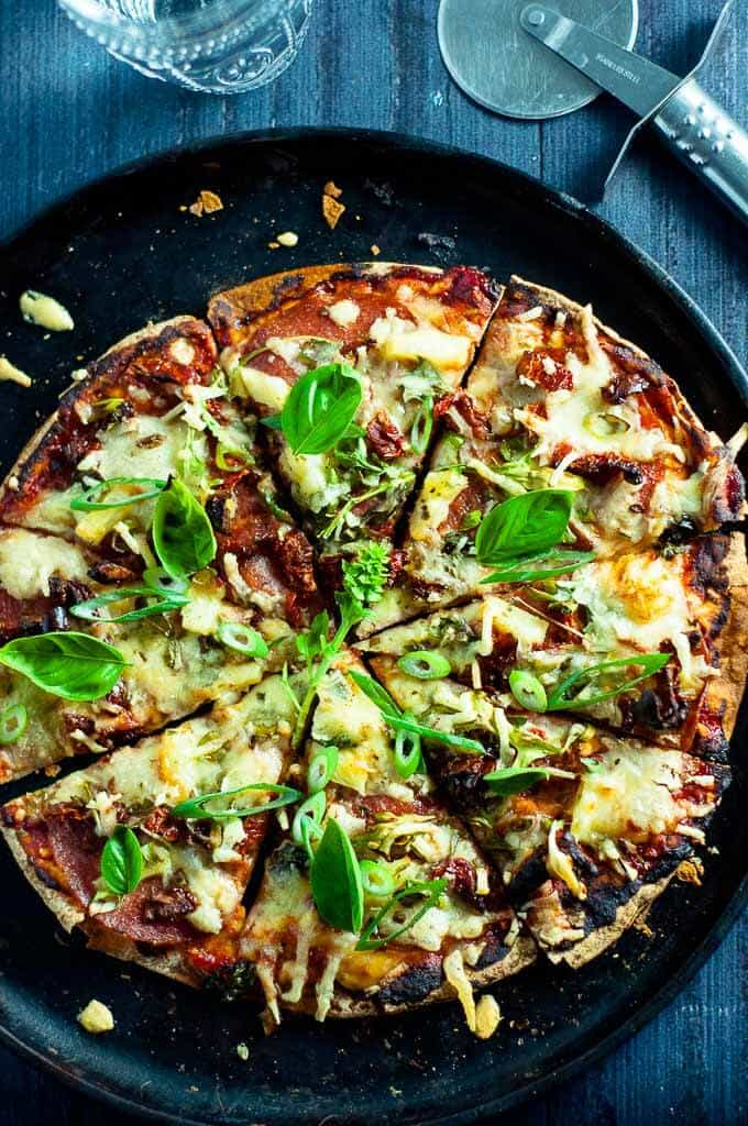 Lebanese bread pizza with salami pineapple and sundried tomato.