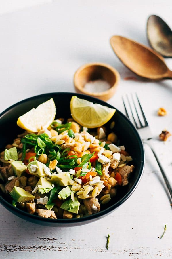Chicken Risoni Salad in a bowl with lemon and shallots, fetta and avocado