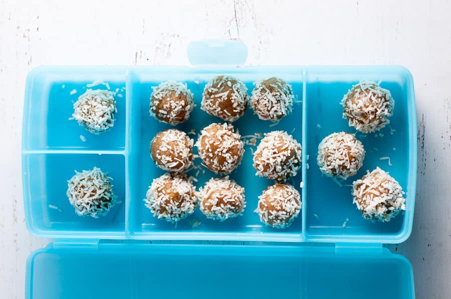 Date free bliss balls in a blue container
