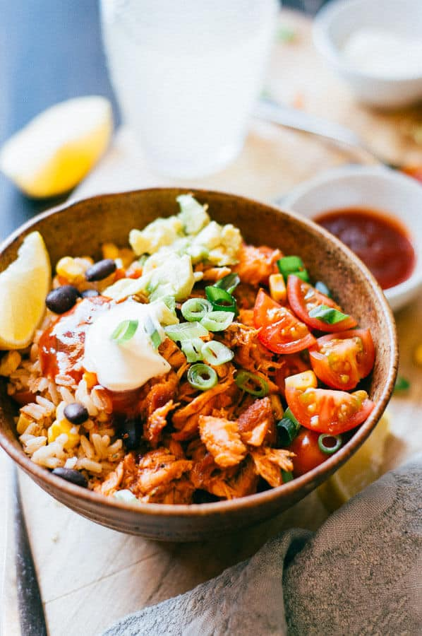 salmon burrito bowl with sour cream close up