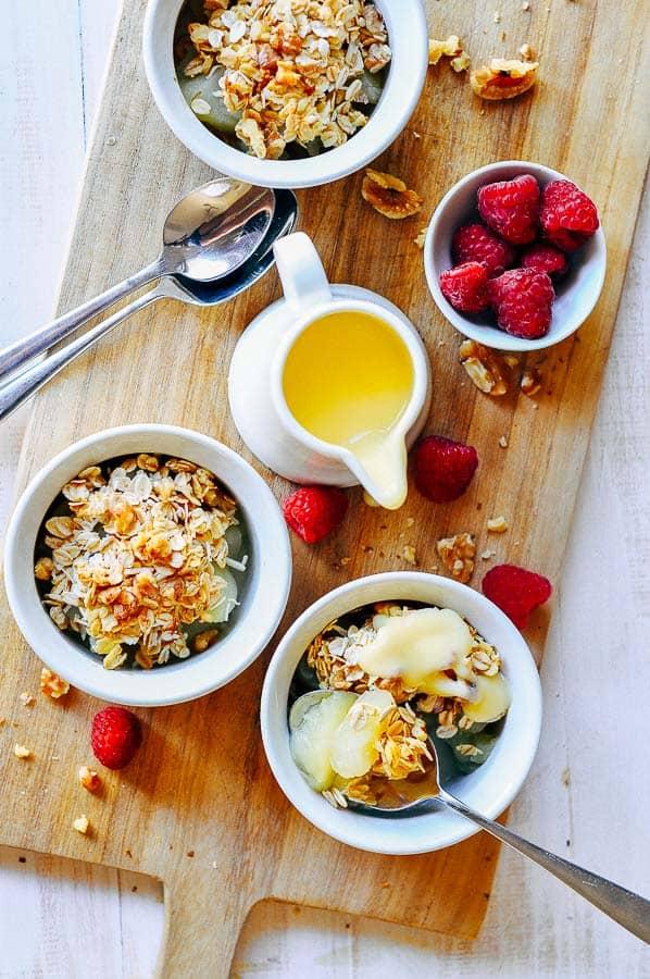 3 ramekins with sugar free apple crumble and raspberries