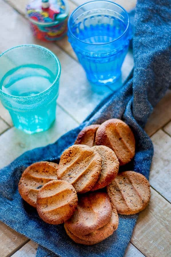 a bunch of ginger biscuits scattered on a blue tea towel