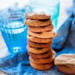 A tall stack of sugar free ginger cookies on a blue towel