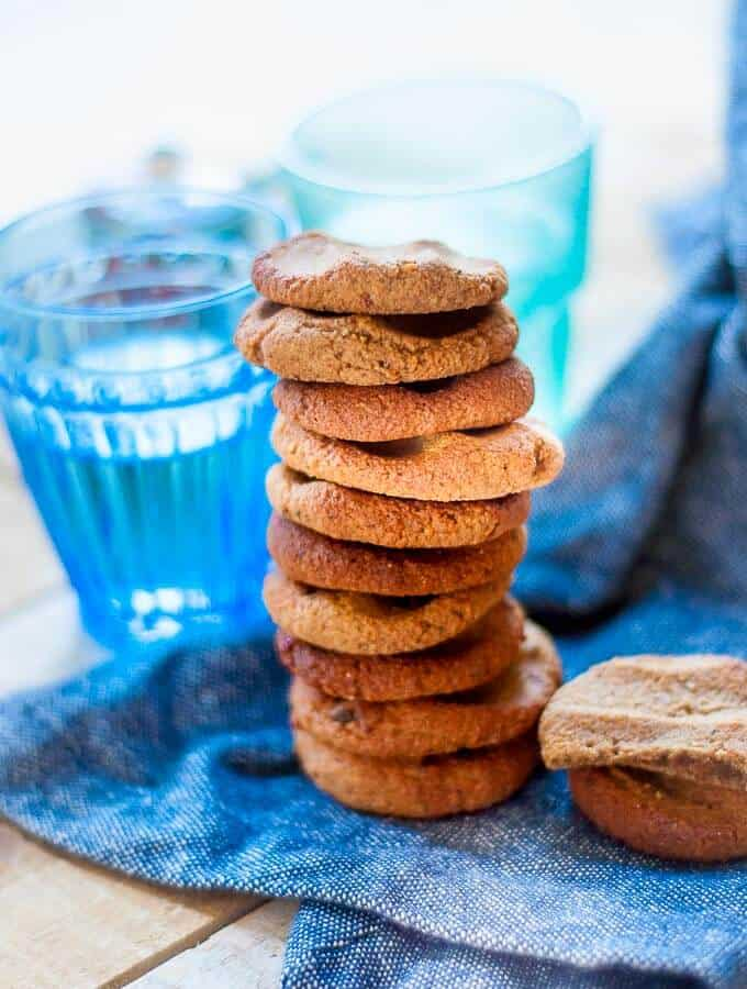 a tall stack of ginger biscuits on a blue tea towel