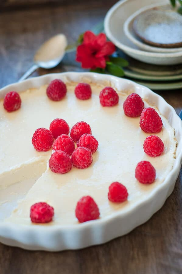 crustless cheesecake with raspberries with a slice out